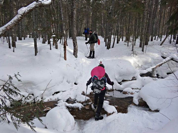 hiking in winter below treeline